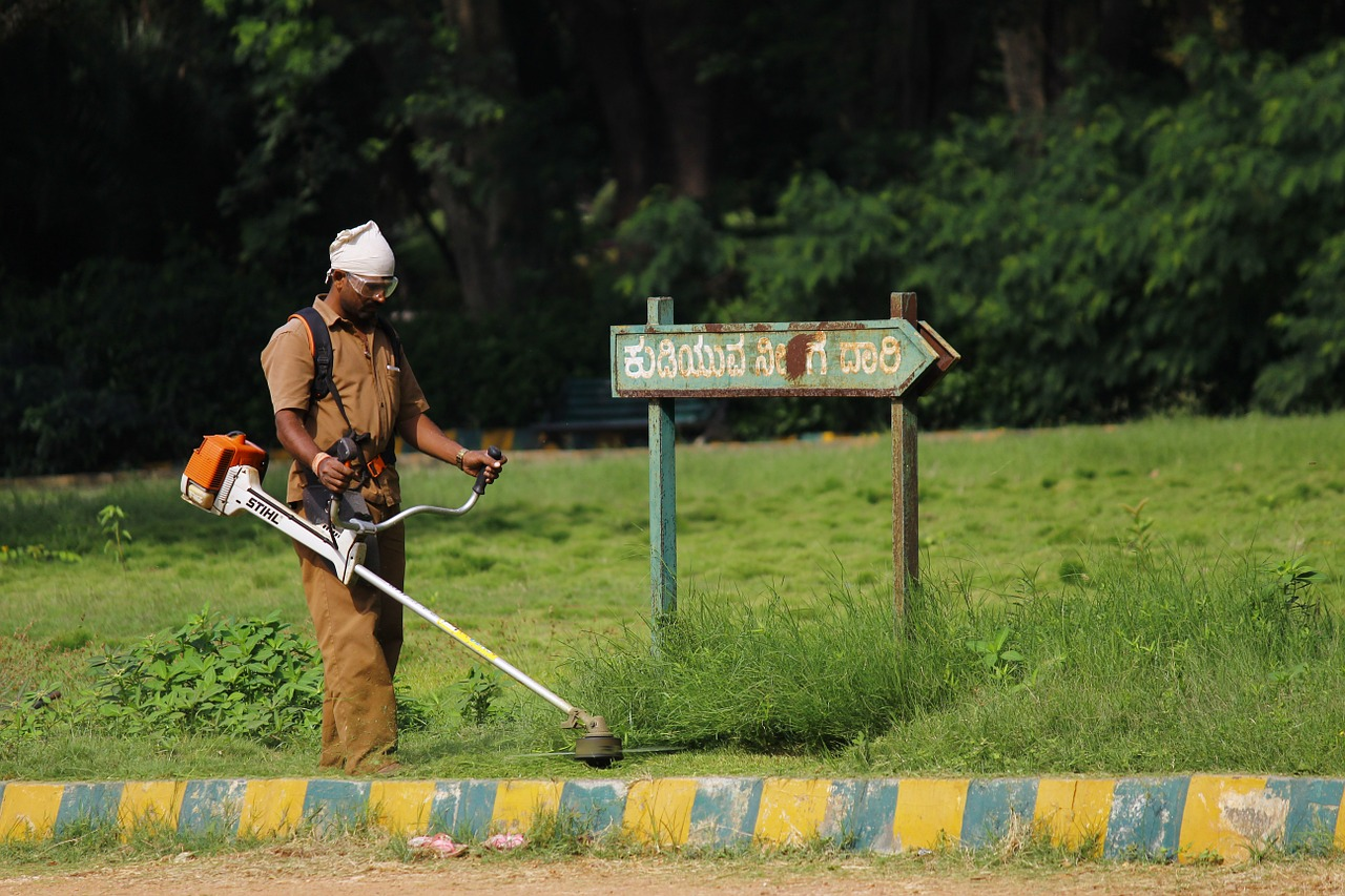 worker using a grass cutter