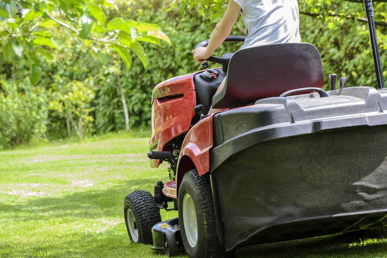 woman mowing the grass with the best riding lawn mower, best riding lawn mower for the money