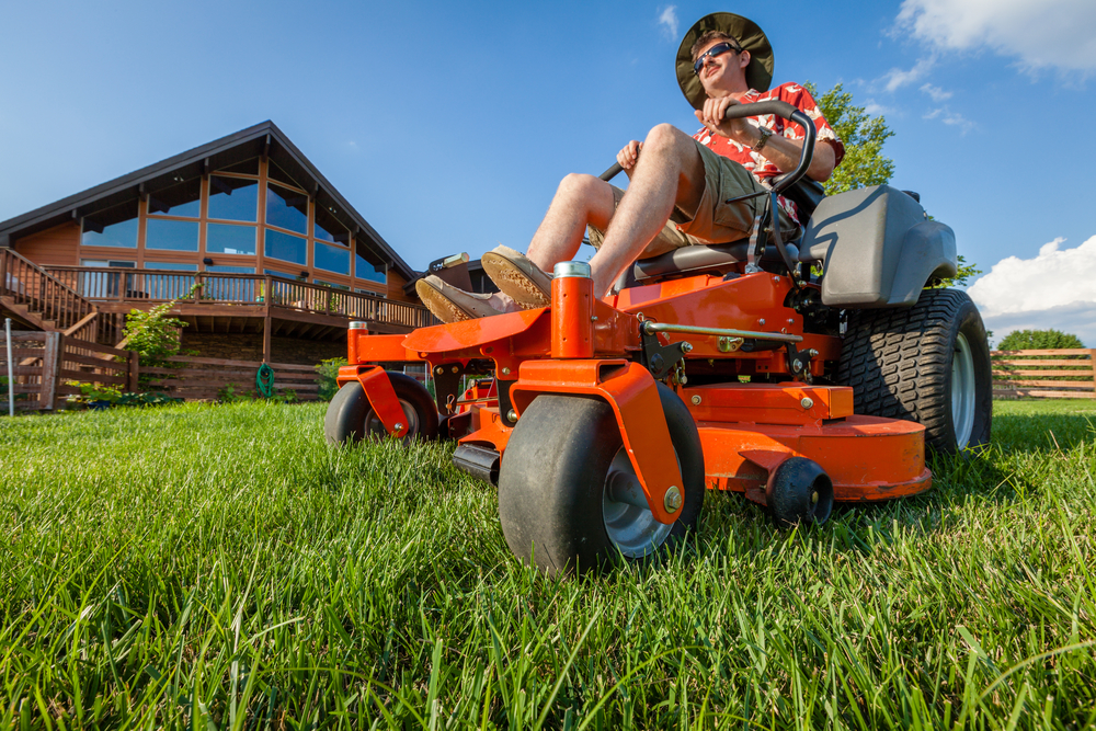 man using the best riding lawn mower