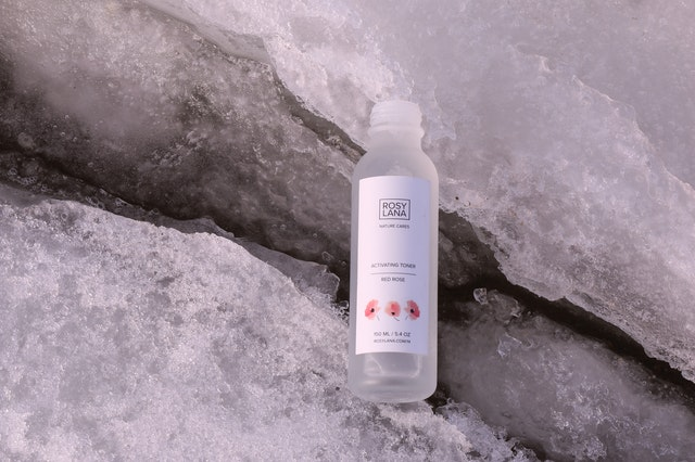 a bottle of toner on top of ice