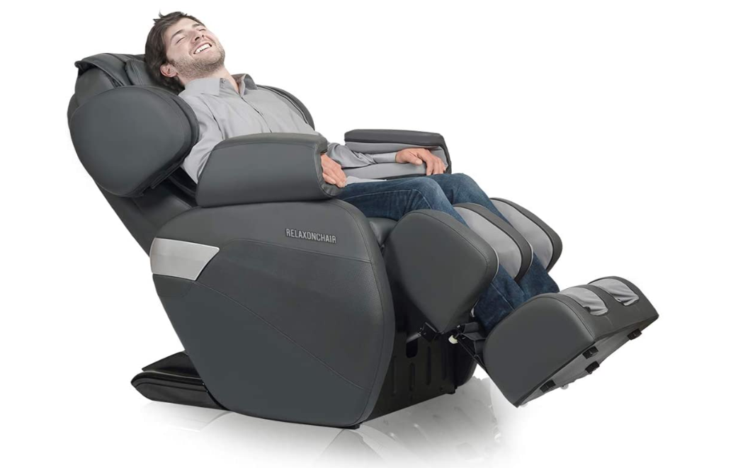 grey best massage chair with man sitting in it.